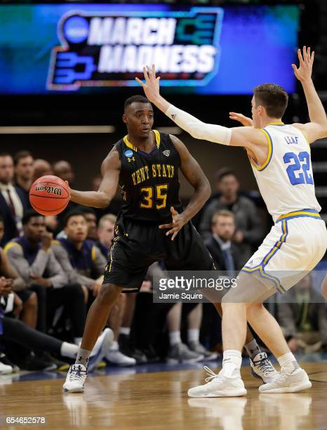 Jimmy Hall of the Kent State Golden Flashes is defended by TJ Leaf of the UCLA Bruinsduring the first round of the 2017 NCAA Men's Basketball...