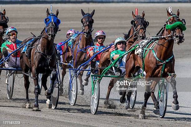 Jimmy Hardy right and horse 'Native Speed' lead the pack during a harness race at Plainridge Racecourse in Plainville He finished second