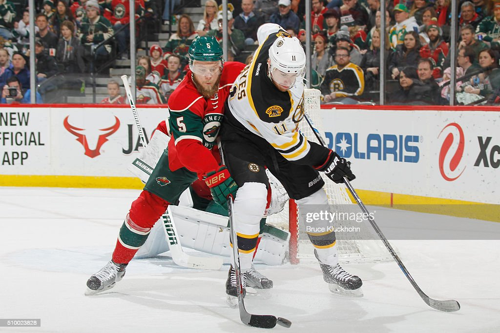 <a gi-track='captionPersonalityLinkClicked' href=/galleries/search?phrase=Jimmy+Hayes+-+Ice+Hockey+Player&family=editorial&specificpeople=10854507 ng-click='$event.stopPropagation()'>Jimmy Hayes</a> #11 of the Boston Bruins and <a gi-track='captionPersonalityLinkClicked' href=/galleries/search?phrase=Christian+Folin&family=editorial&specificpeople=10821892 ng-click='$event.stopPropagation()'>Christian Folin</a> #5 of the Minnesota Wild battle for the puck during the game on February 13, 2016 at the Xcel Energy Center in St. Paul, Minnesota.
