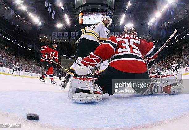 Jimmy Hayes of the Boston Bruins scores a powerplay goal at 1835 of the second period against Cory Schneider of the New Jersey Devils at the...