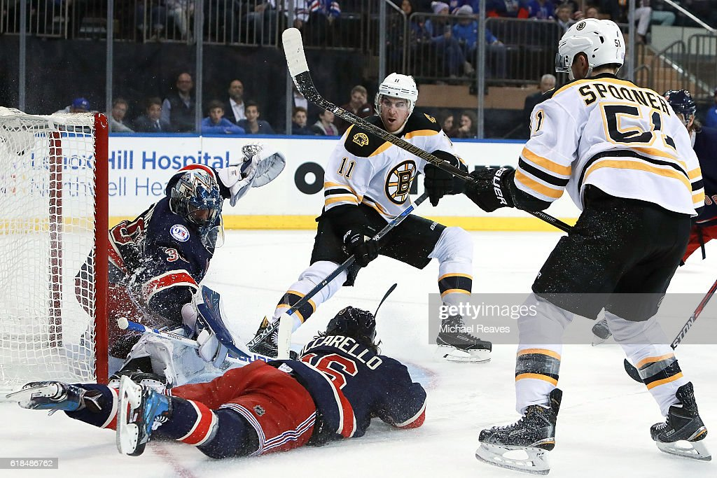 Jimmy Hayes #11 of the Boston Bruins shoots a shot on Henrik Lundqvist #30 of the New York Rangers defended by Mats Zuccarello #36 during the third period at Madison Square Garden on October 26, 2016 in New York City.