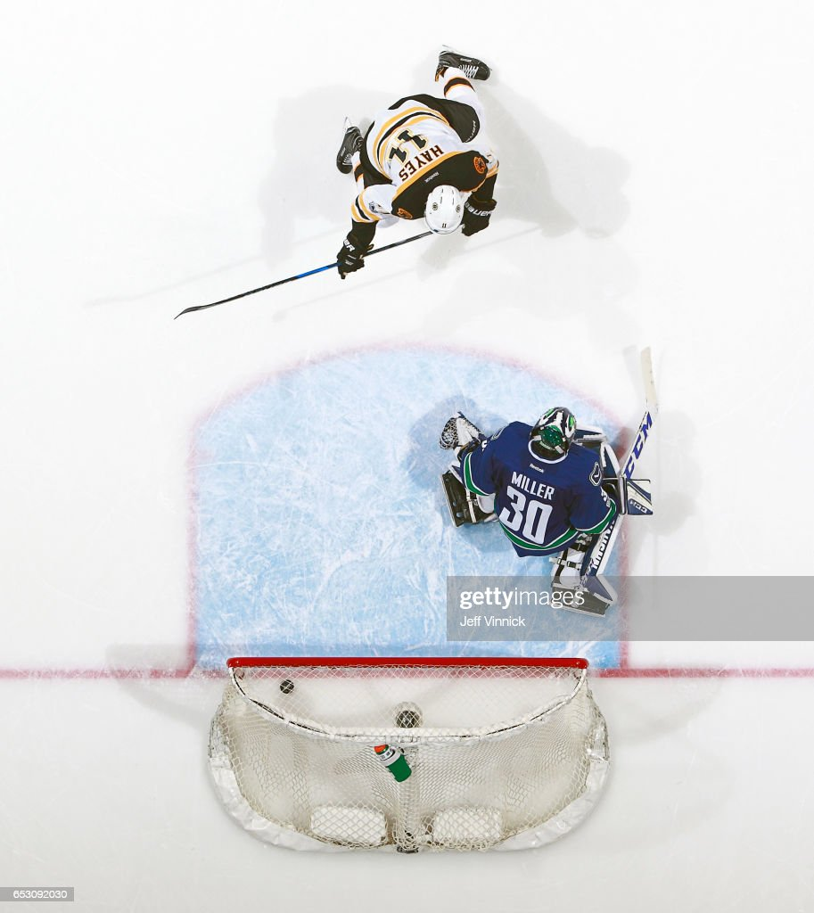 Jimmy Hayes #11 of the Boston Bruins watches the puck get behind Ryan Miller #30 of the Vancouver Canucks for a goal during their NHL game at Rogers Arena March 13, 2017 in Vancouver, British Columbia, Canada. Boston won 6-3.