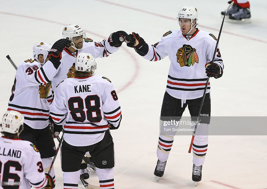 Jimmy Hayes #39 of the Chicago Blackhawks celebrates his goal with Patrick Kane #88, <a gi-track='captionPersonalityLinkClicked' href=/galleries/search?phrase=Johnny+Oduya&family=editorial&specificpeople=3944055 ng-click='$event.stopPropagation()'>Johnny Oduya</a> #27, <a gi-track='captionPersonalityLinkClicked' href=/galleries/search?phrase=Michal+Rozsival&family=editorial&specificpeople=216462 ng-click='$event.stopPropagation()'>Michal Rozsival</a> #32 and Dave Bolland #36 in the first period during an NHL game against the Detroit Red Wings at Joe Louis Arena on March 31, 2013 in Detroit, Michigan.