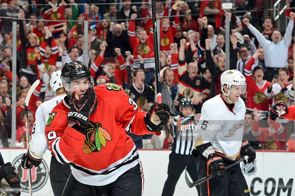 Jimmy Hayes #39 of the Chicago Blackhawks reacts after teammate Patrick Kane #88 scored, as <a gi-track='captionPersonalityLinkClicked' href=/galleries/search?phrase=Ben+Lovejoy&family=editorial&specificpeople=4509565 ng-click='$event.stopPropagation()'>Ben Lovejoy</a> #6 of the Anaheim Ducks stands in the background, during the NHL game on March 29, 2013 at the United Center in Chicago, Illinois.