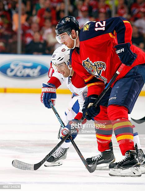 Jimmy Hayes of the Florida Panthers gets set for a faceoff with Max Pacioretty of the Montreal Canadiens at the BBT Center on March 17 2015 in...