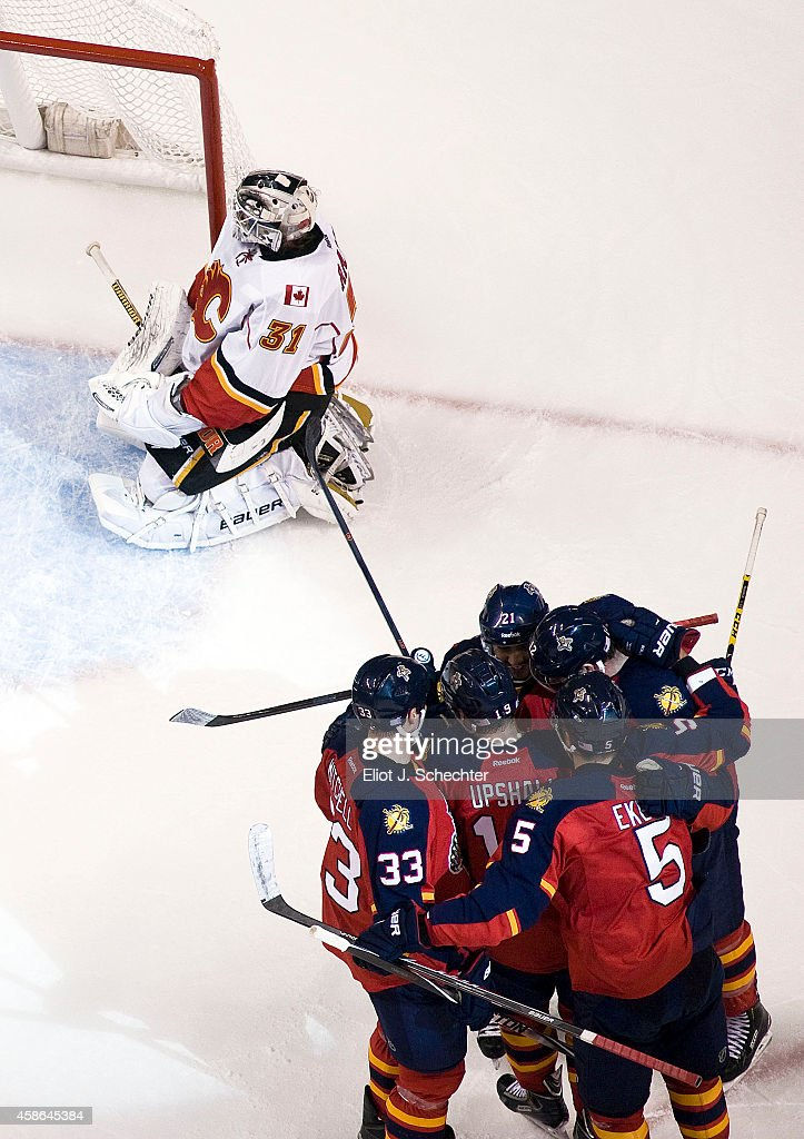 Jimmy Hayes #12 of the Florida Panthers is swarmed by teammates after scoring a goal against Goaltender Karri Ramo #31 of the Calgary Flames at the BB&T Center on November 8, 2014 in Sunrise, Florida.