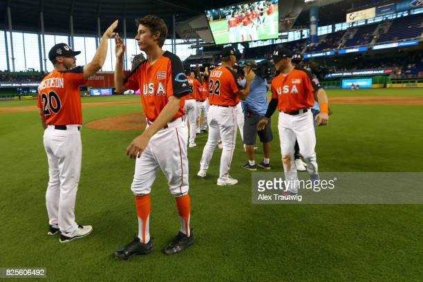 Jimmy Herget of Team USA celebrates with teammates after defeating the World Teain in the SirusXM AllStar Futures Game at Marlins Park on Sunday July...