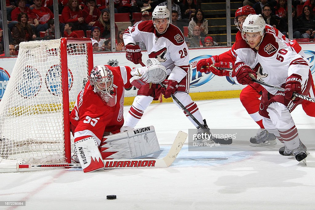 <a gi-track='captionPersonalityLinkClicked' href=/galleries/search?phrase=Jimmy+Howard&family=editorial&specificpeople=2118637 ng-click='$event.stopPropagation()'>Jimmy Howard</a> #35 and Danny DeKeyser #65 of the Detroit Red Wings as well as <a gi-track='captionPersonalityLinkClicked' href=/galleries/search?phrase=Lauri+Korpikoski&family=editorial&specificpeople=2108074 ng-click='$event.stopPropagation()'>Lauri Korpikoski</a> #28 and <a gi-track='captionPersonalityLinkClicked' href=/galleries/search?phrase=Antoine+Vermette&family=editorial&specificpeople=206302 ng-click='$event.stopPropagation()'>Antoine Vermette</a> #50 of the Phoenix Coyotes all have an eye on the puck as it squirts free to the side of the net during a NHL game at Joe Louis Arena on April 22, 2013 in Detroit, Michigan.