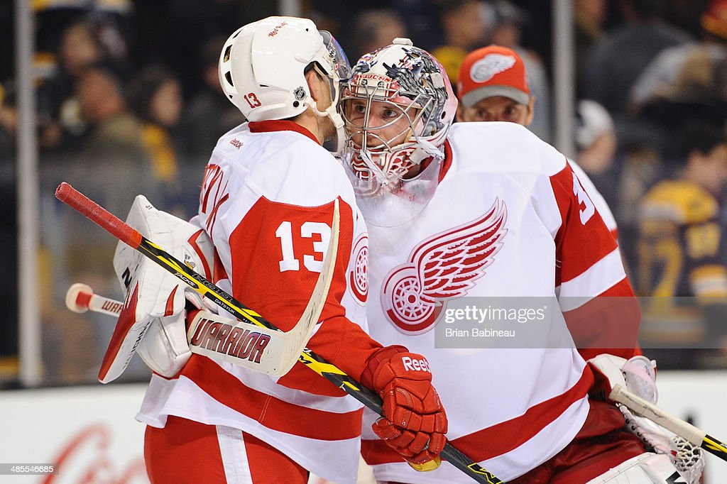 <a gi-track='captionPersonalityLinkClicked' href=/galleries/search?phrase=Jimmy+Howard&family=editorial&specificpeople=2118637 ng-click='$event.stopPropagation()'>Jimmy Howard</a> #35 and <a gi-track='captionPersonalityLinkClicked' href=/galleries/search?phrase=Pavel+Datsyuk&family=editorial&specificpeople=202893 ng-click='$event.stopPropagation()'>Pavel Datsyuk</a> #13 of the Detroit Red Wings celebrate a shutout win against the Boston Bruins in Game One of the First Round of the 2014 Stanley Cup Playoffs at TD Garden on April 18, 2014 in Boston, Massachusetts.