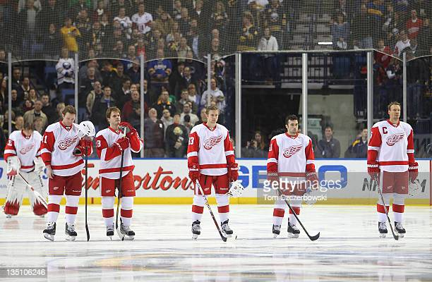 Jimmy Howard Danny Cleary Ian White Darren Helm Chris Conner and Nicklas Lidstrom of the Detroit Red Wings stand for the playing of the anthem before...