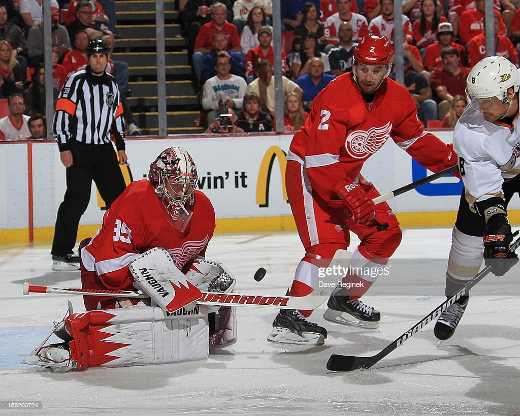 <a gi-track='captionPersonalityLinkClicked' href=/galleries/search?phrase=Jimmy+Howard&family=editorial&specificpeople=2118637 ng-click='$event.stopPropagation()'>Jimmy Howard</a> #35 makes a save as teammate Brendan Smith #2 of the Detroit Red Wings defends against Teemu Selanne #8 of the Anaheim Ducks during Game Four of the Western Conference Quarterfinals during the 2013 NHL Stanley Cup Playoffs at Joe Louis Arena on May 6, 2013 in Detroit, Michigan.