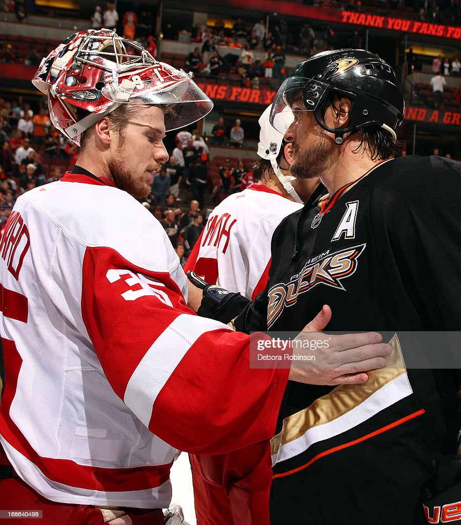 Jimmy Howard #35 of the Detroit Red Wings and Teemu Selanne #8 of the Anaheim Ducks participate in the post game player handshake after the Red Wings 3-2 victory in Game Seven of the Western Conference Quarterfinals during the 2013 NHL Stanley Cup Playoffs at Honda Center on May 12, 2013 in Anaheim, California.