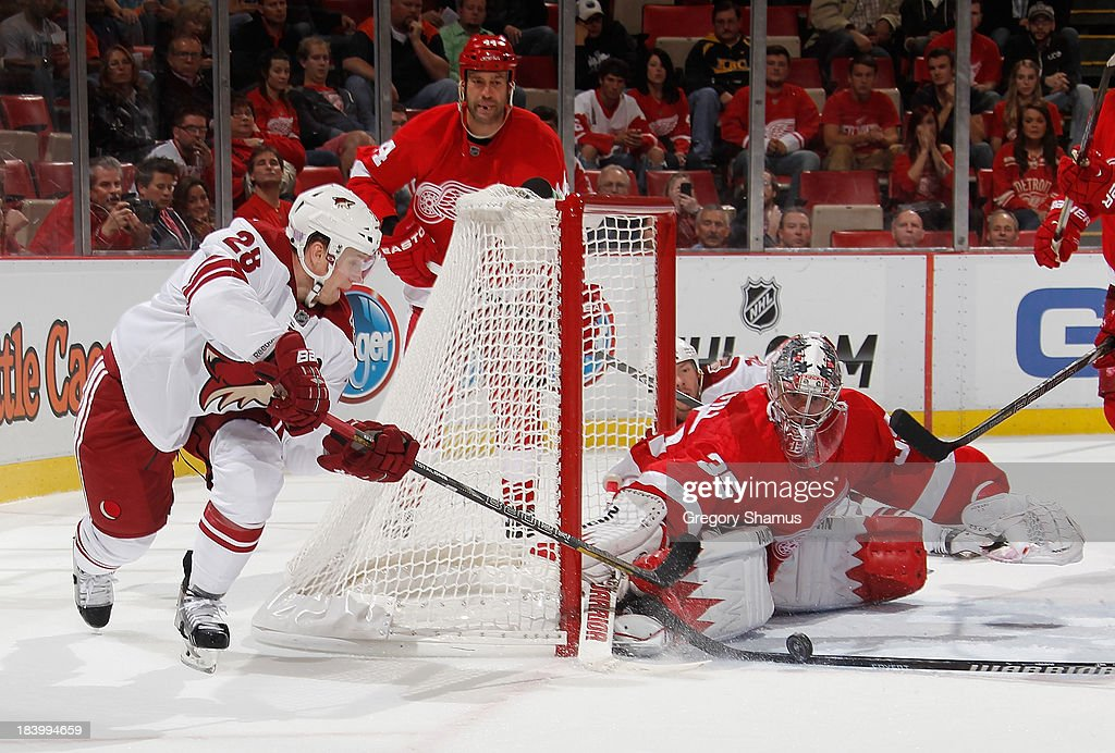 <a gi-track='captionPersonalityLinkClicked' href=/galleries/search?phrase=Jimmy+Howard&family=editorial&specificpeople=2118637 ng-click='$event.stopPropagation()'>Jimmy Howard</a> #35 of the Detroit Red Wings blocks the third period shot by <a gi-track='captionPersonalityLinkClicked' href=/galleries/search?phrase=Lauri+Korpikoski&family=editorial&specificpeople=2108074 ng-click='$event.stopPropagation()'>Lauri Korpikoski</a> #28 of the Phoenix Coyotes at Joe Louis Arena on October 10, 2013 in Detroit, Michigan. Phoenix won the game 4-2.