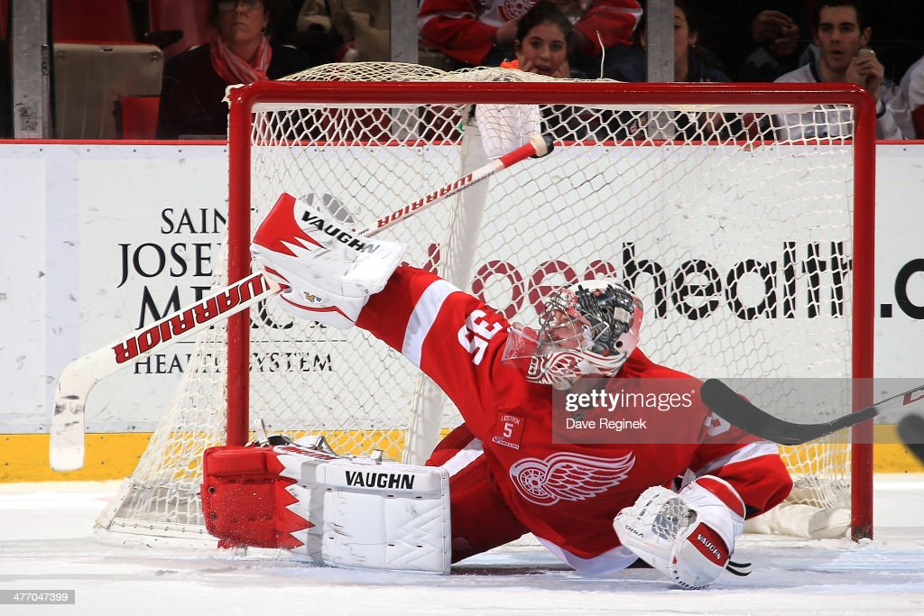 <a gi-track='captionPersonalityLinkClicked' href=/galleries/search?phrase=Jimmy+Howard&family=editorial&specificpeople=2118637 ng-click='$event.stopPropagation()'>Jimmy Howard</a> #35 of the Detroit Red Wings can't make the stop on a shot by Andre Benoit (not pictured) of the Colorado Avalanche on the game-winning goal in overtime during an NHL game on March 6, 2014 at Joe Louis Arena in Detroit, Michigan. Colorado defeated Detroit 3-2 in overtime