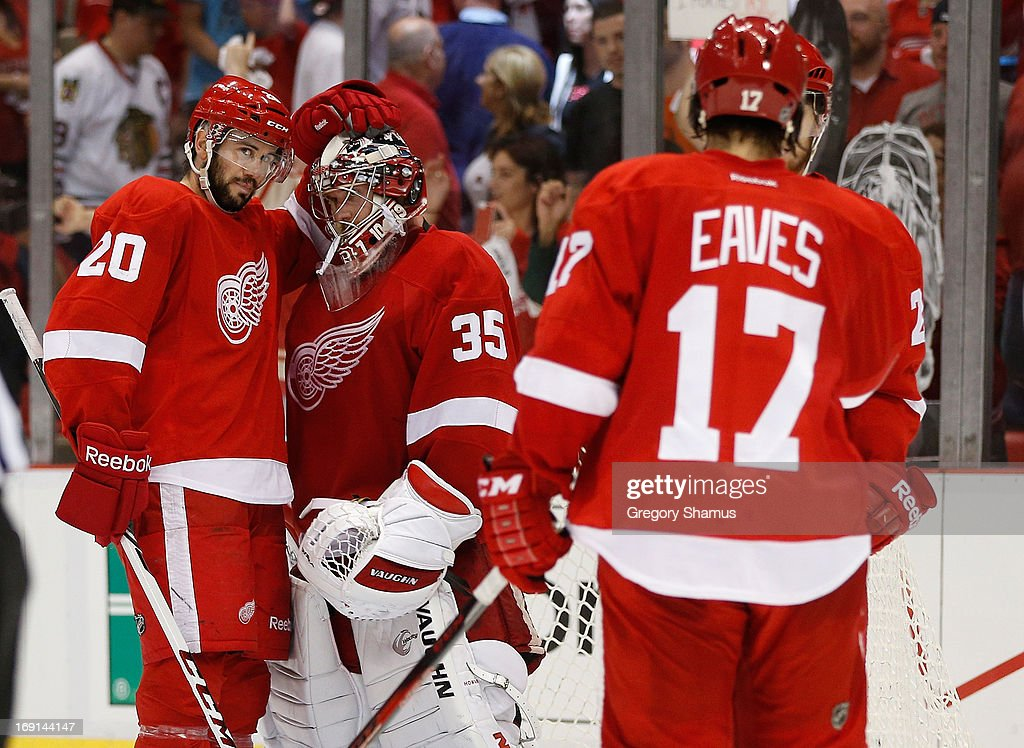 Jimmy Howard #35 of the Detroit Red Wings celebrates a 3-1 win over the Chicago Blackhawks with Drew Miller #20 and Patrick Eaves #17 in Game Three of the Western Conference Semifinals during the 2013 NHL Stanley Cup Playoffs at Joe Louis Arena on May 20, 2013 in Detroit, Michigan. Detroit leads the series 2-1.