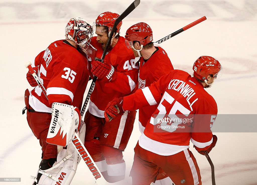 <a gi-track='captionPersonalityLinkClicked' href=/galleries/search?phrase=Jimmy+Howard&family=editorial&specificpeople=2118637 ng-click='$event.stopPropagation()'>Jimmy Howard</a> #35 of the Detroit Red Wings celebrates a 3-2 overtime win over the Anaheim Ducks with <a gi-track='captionPersonalityLinkClicked' href=/galleries/search?phrase=Henrik+Zetterberg&family=editorial&specificpeople=201520 ng-click='$event.stopPropagation()'>Henrik Zetterberg</a> #40, <a gi-track='captionPersonalityLinkClicked' href=/galleries/search?phrase=Daniel+Cleary&family=editorial&specificpeople=220490 ng-click='$event.stopPropagation()'>Daniel Cleary</a> #11 and <a gi-track='captionPersonalityLinkClicked' href=/galleries/search?phrase=Niklas+Kronwall&family=editorial&specificpeople=220826 ng-click='$event.stopPropagation()'>Niklas Kronwall</a> #55 in Game Four of the Western Conference Quarterfinals during the 2013 NHL Stanley Cup Playoffs at Joe Louis Arena on May 6, 2013 in Detroit, Michigan. The series is tied 2-2.