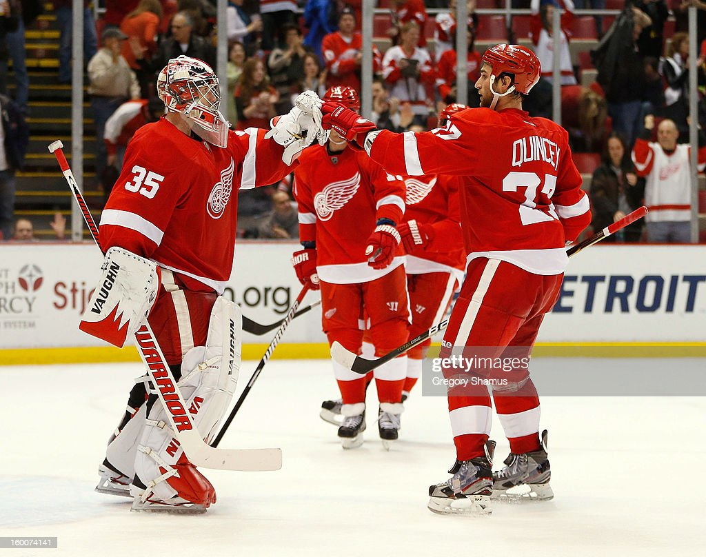 <a gi-track='captionPersonalityLinkClicked' href=/galleries/search?phrase=Jimmy+Howard&family=editorial&specificpeople=2118637 ng-click='$event.stopPropagation()'>Jimmy Howard</a> #35 of the Detroit Red Wings celebrates a 5-3 win over the Minnesota Wild with <a gi-track='captionPersonalityLinkClicked' href=/galleries/search?phrase=Kyle+Quincey&family=editorial&specificpeople=2234340 ng-click='$event.stopPropagation()'>Kyle Quincey</a> #27 at Joe Louis Arena on January 25, 2013 in Detroit, Michigan.