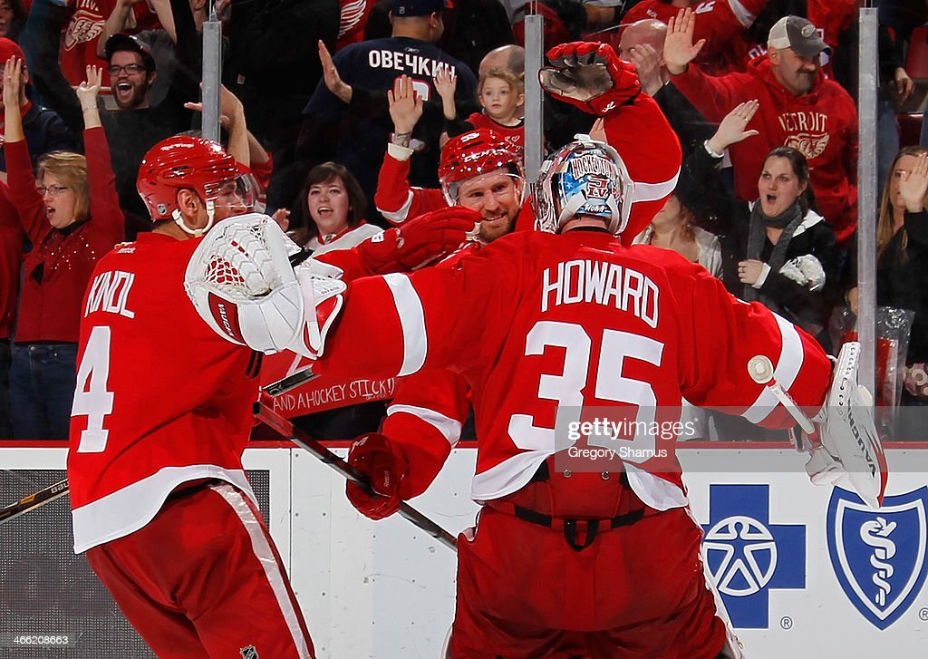 <a gi-track='captionPersonalityLinkClicked' href=/galleries/search?phrase=Jimmy+Howard&family=editorial&specificpeople=2118637 ng-click='$event.stopPropagation()'>Jimmy Howard</a> #35 of the Detroit Red Wings celebrates a shootout victory over the Washington Capitals with <a gi-track='captionPersonalityLinkClicked' href=/galleries/search?phrase=Niklas+Kronwall&family=editorial&specificpeople=220826 ng-click='$event.stopPropagation()'>Niklas Kronwall</a> #55 and <a gi-track='captionPersonalityLinkClicked' href=/galleries/search?phrase=Jakub+Kindl&family=editorial&specificpeople=716743 ng-click='$event.stopPropagation()'>Jakub Kindl</a> #4 while at Joe Louis Arena on January 31, 2014 in Detroit, Michigan.