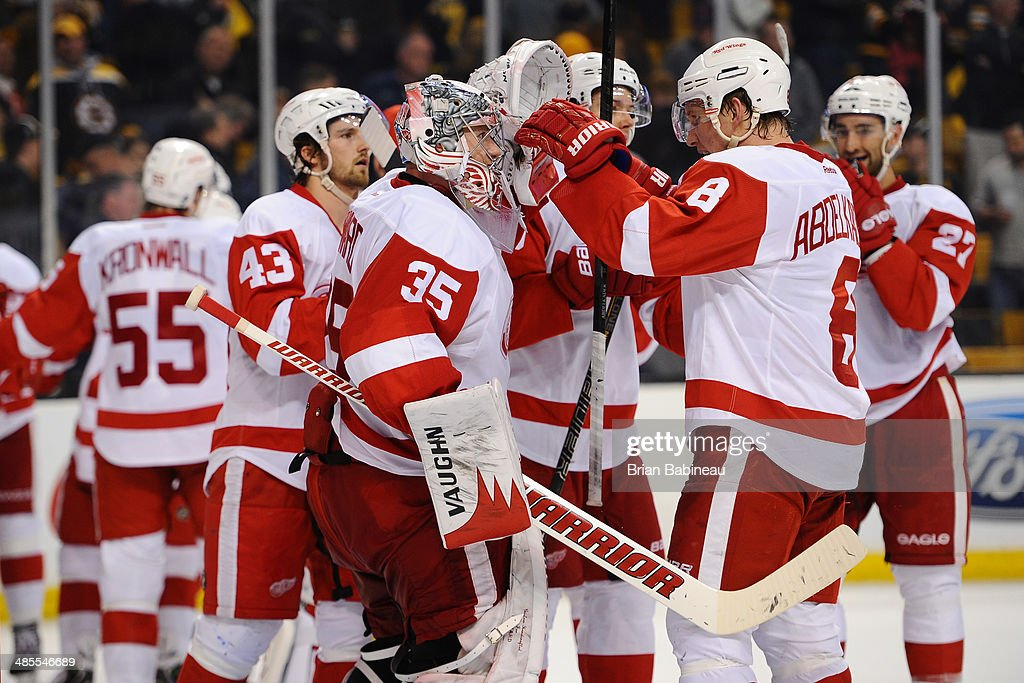 <a gi-track='captionPersonalityLinkClicked' href=/galleries/search?phrase=Jimmy+Howard&family=editorial&specificpeople=2118637 ng-click='$event.stopPropagation()'>Jimmy Howard</a> #35 of the Detroit Red Wings celebrates a shutout win with his team mates against the Boston Bruins in Game One of the First Round of the 2014 Stanley Cup Playoffs at TD Garden on April 18, 2014 in Boston, Massachusetts.