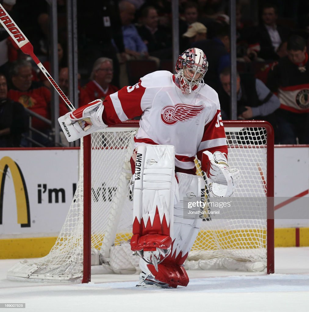 Jimmy Howard of the Detroit Red Wings celebrates a win over the Chicago Blackhawks in Game Two of the Western Conference Semifinals during the 2013...