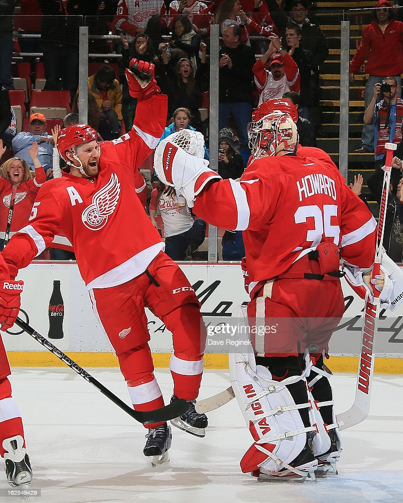 <a gi-track='captionPersonalityLinkClicked' href=/galleries/search?phrase=Jimmy+Howard&family=editorial&specificpeople=2118637 ng-click='$event.stopPropagation()'>Jimmy Howard</a> #35 of the Detroit Red Wings celebrates the 8-3 win over the Vancouver Canucks with <a gi-track='captionPersonalityLinkClicked' href=/galleries/search?phrase=Niklas+Kronwall&family=editorial&specificpeople=220826 ng-click='$event.stopPropagation()'>Niklas Kronwall</a> #55 after a NHL game at Joe Louis Arena on February 24, 2013 in Detroit, Michigan.
