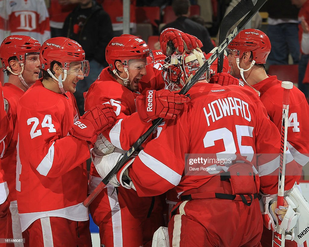 Jimmy Howard #35 of the Detroit Red Wings celebrates the win with teammates Damien Brunner #24 and Niklas Kronwall #55 after a NHL game against the Los Angeles Kings at Joe Louis Arena on February 10, 2013 in Detroit, Michigan. Detroit defeated Los Angeles 3-2