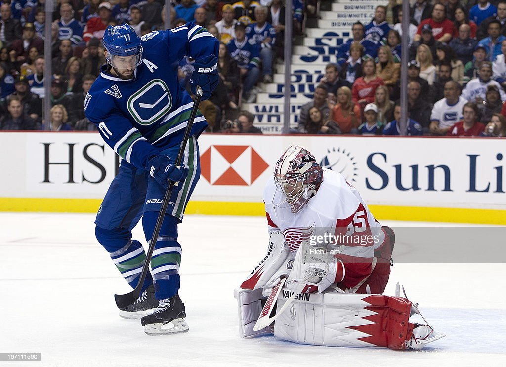 Jimmy Howard #35 of the Detroit Red Wings covers up the puck after making a save with Ryan Kesler #17 of the Vancouver Canucks standing right in front of the net during the second period in NHL action on April 20, 2013 at Rogers Arena in Vancouver, British Columbia, Canada.