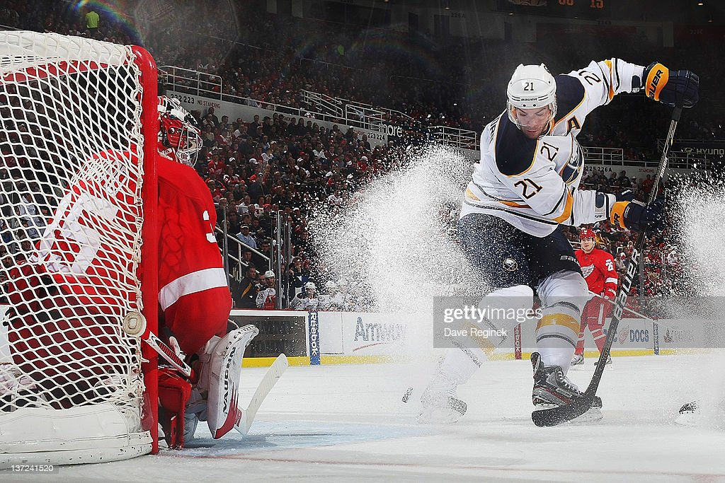 <a gi-track='captionPersonalityLinkClicked' href=/galleries/search?phrase=Jimmy+Howard&family=editorial&specificpeople=2118637 ng-click='$event.stopPropagation()'>Jimmy Howard</a> #35 of the Detroit Red Wings gets ready to make a save on <a gi-track='captionPersonalityLinkClicked' href=/galleries/search?phrase=Drew+Stafford&family=editorial&specificpeople=220617 ng-click='$event.stopPropagation()'>Drew Stafford</a> #21 of the Buffalo Sabres during an NHL game at Joe Louis Arena on January 16, 2012 in Detroit, Michigan.