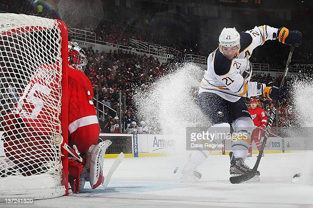 Jimmy Howard of the Detroit Red Wings gets ready to make a save on Drew Stafford of the Buffalo Sabres during an NHL game at Joe Louis Arena on...