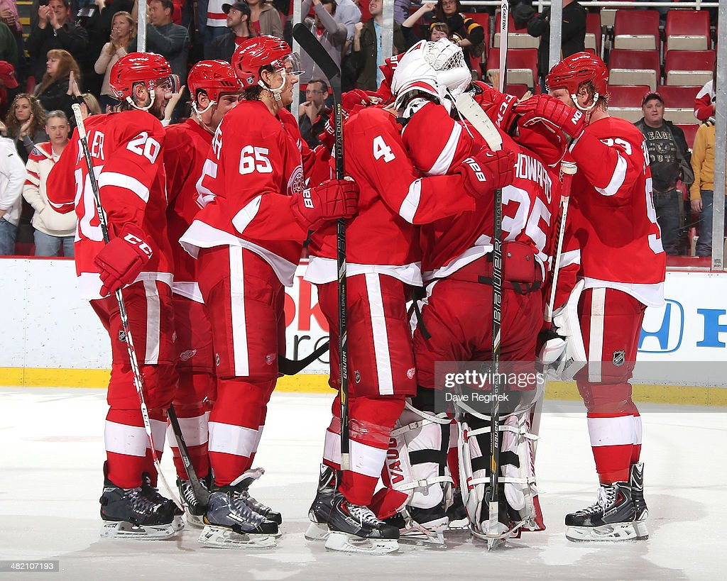 <a gi-track='captionPersonalityLinkClicked' href=/galleries/search?phrase=Jimmy+Howard&family=editorial&specificpeople=2118637 ng-click='$event.stopPropagation()'>Jimmy Howard</a> #35 of the Detroit Red Wings gets surrounded by teammates after an NHL game against the Boston Bruins on April 2, 2014 at Joe Louis Arena in Detroit, Michigan. Detroit defeated Boston 3-2
