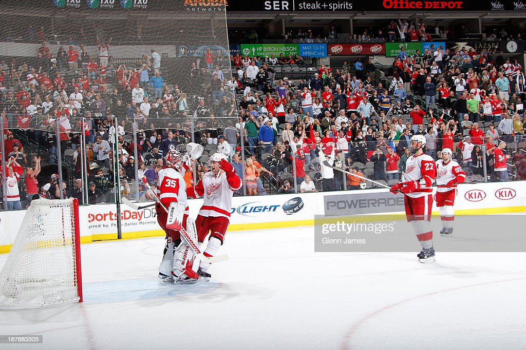 Jimmy Howard #35 of the Detroit Red Wings is congratulated by his teammates on a playoff birth clenching win against the Dallas Stars at the American Airlines Center on April 27, 2013 in Dallas, Texas.