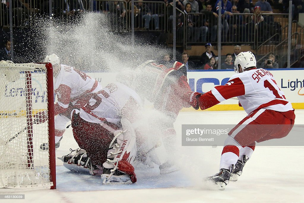 <a gi-track='captionPersonalityLinkClicked' href=/galleries/search?phrase=Jimmy+Howard&family=editorial&specificpeople=2118637 ng-click='$event.stopPropagation()'>Jimmy Howard</a> #35 of the Detroit Red Wings is sprayed with ice as <a gi-track='captionPersonalityLinkClicked' href=/galleries/search?phrase=Derick+Brassard&family=editorial&specificpeople=540468 ng-click='$event.stopPropagation()'>Derick Brassard</a> #16 of the New York Rangers cuts through the crease during the second period at Madison Square Garden on January 16, 2014 in New York City.