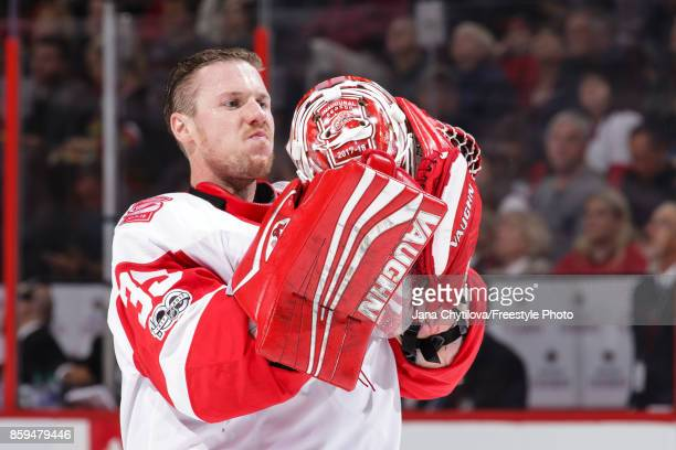 Jimmy Howard of the Detroit Red Wings looks at his mask during a stoppage in play against the Ottawa Senators at Canadian Tire Centre on October 7...