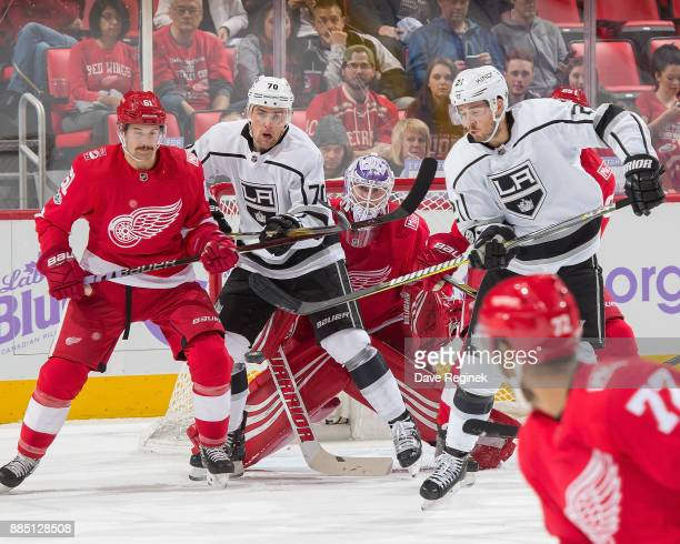 Jimmy Howard of the Detroit Red Wings looks for the puck as teammate Xavier Ouellet of the Wings battles in front with Tanner Pearson and Nick Shore...