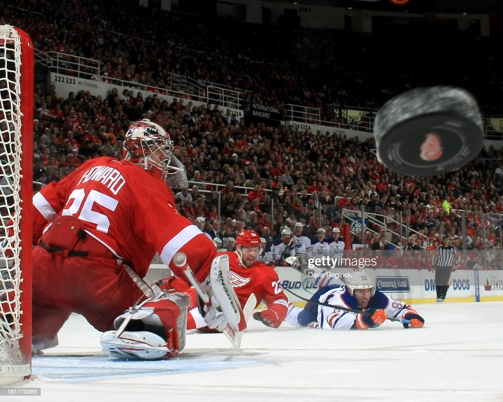 Jimmy Howard of the Detroit Red Wings makes a blocker save deflecting the puck into the corner during a NHL game against the Edmonton Oilers at Joe...