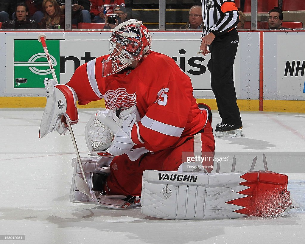 Jimmy Howard #35 of the Detroit Red Wings makes a blocker save during an NHL game against the Chicago Blackhawks at Joe Louis Arena on March 3, 2013 in Detroit, Michigan.