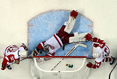 Jimmy Howard of the Detroit Red Wings makes a diving save during the second period of their game against the San Jose Sharks in Game Two of the...