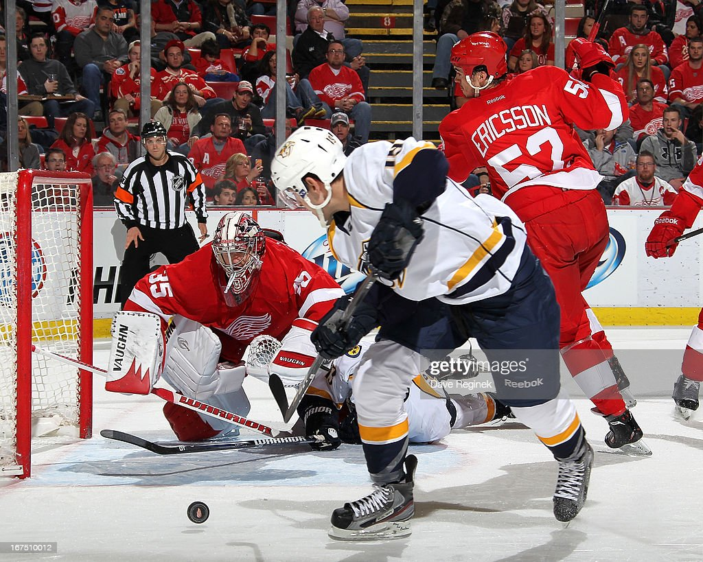Jimmy Howard of the Detroit Red Wings makes a diving save on Bobby Butler of the Nashville Predators during a NHL game at Joe Louis Arena on April 25...