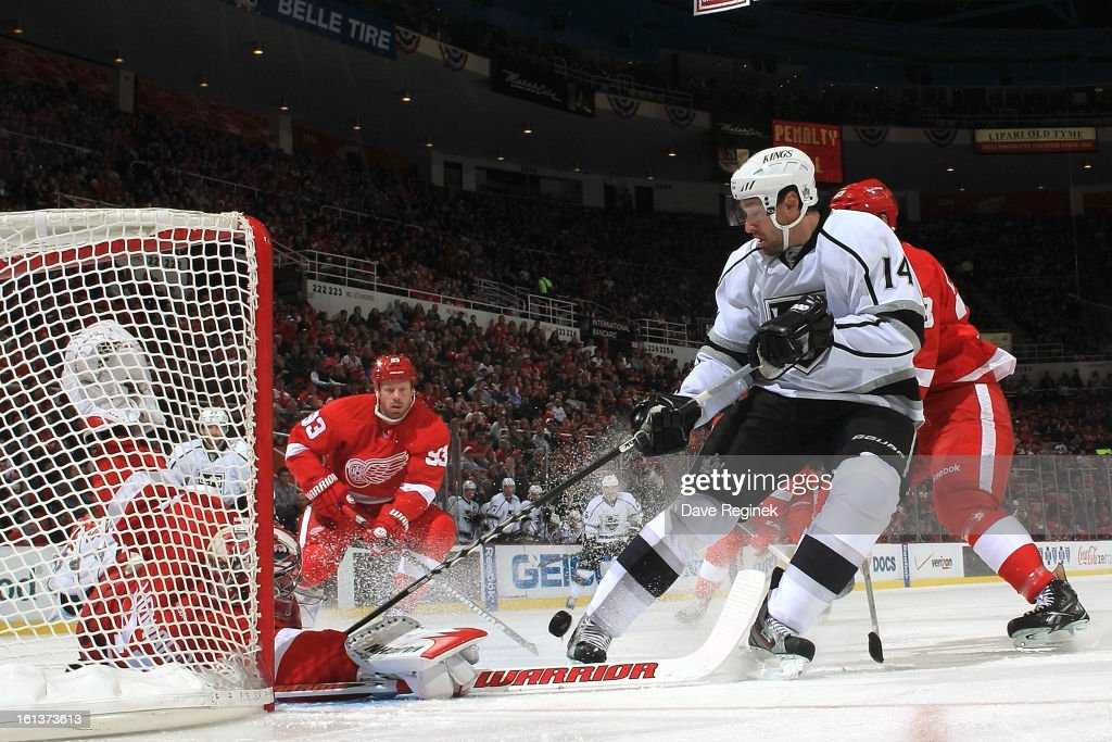 <a gi-track='captionPersonalityLinkClicked' href=/galleries/search?phrase=Jimmy+Howard&family=editorial&specificpeople=2118637 ng-click='$event.stopPropagation()'>Jimmy Howard</a> #35 of the Detroit Red Wings makes a diving save on Justin Williams #14 of the Los Angeles Kings during a NHL game at Joe Louis Arena on February 10, 2013 in Detroit, Michigan.