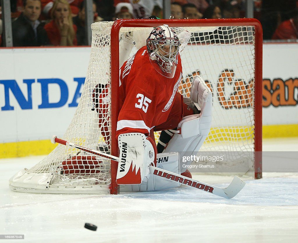 <a gi-track='captionPersonalityLinkClicked' href=/galleries/search?phrase=Jimmy+Howard&family=editorial&specificpeople=2118637 ng-click='$event.stopPropagation()'>Jimmy Howard</a> #35 of the Detroit Red Wings makes a first period save while plain the Chicago Blackhawks in Game Four of the Western Conference Semifinals during the 2013 NHL Stanley Cup Playoffs at Joe Louis Arena on May 23, 2013 in Detroit, Michigan. Detroit won the game 2-0 to take a 3-1 series lead.