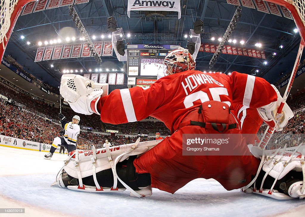 <a gi-track='captionPersonalityLinkClicked' href=/galleries/search?phrase=Jimmy+Howard&family=editorial&specificpeople=2118637 ng-click='$event.stopPropagation()'>Jimmy Howard</a> #35 of the Detroit Red Wings makes a glove save on a shot by Gabriel Bourque #57 of the Nashville Predators during Game Four of the Western Conference Quarterfinals during the 2012 NHL Stanley Cup Playoffs at Joe Louis Arena on April 17, 2012 in Detroit, Michigan. Nashville won the game 3-1 and lead the series 3-1.