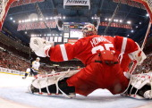 Jimmy Howard of the Detroit Red Wings makes a glove save on a shot by Gabriel Bourque of the Nashville Predators during Game Four of the Western...
