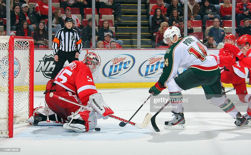 <a gi-track='captionPersonalityLinkClicked' href=/galleries/search?phrase=Jimmy+Howard&family=editorial&specificpeople=2118637 ng-click='$event.stopPropagation()'>Jimmy Howard</a> #35 of the Detroit Red Wings makes a pad save on <a gi-track='captionPersonalityLinkClicked' href=/galleries/search?phrase=Darroll+Powe&family=editorial&specificpeople=4527845 ng-click='$event.stopPropagation()'>Darroll Powe</a> #14 of the Minnesota Wild during their NHL game at Joe Louis Arena on March 2, 2012 in Detroit, Michigan.