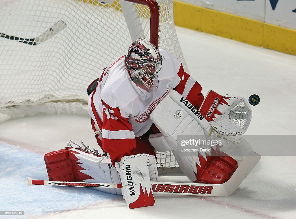 <a gi-track='captionPersonalityLinkClicked' href=/galleries/search?phrase=Jimmy+Howard&family=editorial&specificpeople=2118637 ng-click='$event.stopPropagation()'>Jimmy Howard</a> #35 of the Detroit Red Wings makes a save against the Chicago Blackhawks in Game Two of the Western Conference Semifinals during the 2013 NHL Stanley Cup Playoffs at the United Center on May 18, 2013 in Chicago, Illinois. The Red Wings defeated the Blackhawks 4-1.