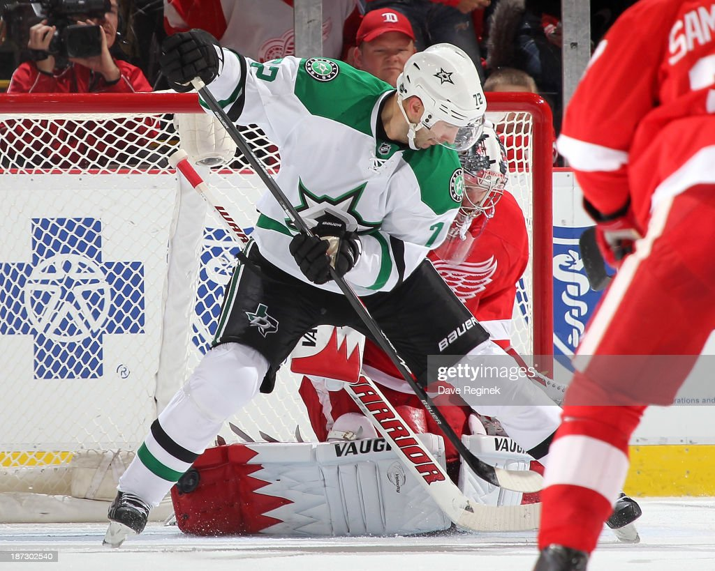 Jimmy Howard #35 of the Detroit Red Wings makes a save as Erik Cole #72 of the Dallas Stars screens him in front of the net during an NHL game at Joe Louis Arena on November 7, 2013 in Detroit, Michigan. Dallas defeated Detroit 4-3 in OT