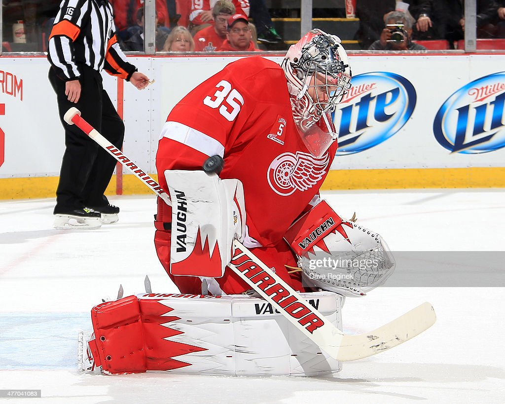 <a gi-track='captionPersonalityLinkClicked' href=/galleries/search?phrase=Jimmy+Howard&family=editorial&specificpeople=2118637 ng-click='$event.stopPropagation()'>Jimmy Howard</a> #35 of the Detroit Red Wings makes a save during an NHL game against the Colorado Avalanche on March 6, 2014 at Joe Louis Arena in Detroit, Michigan.