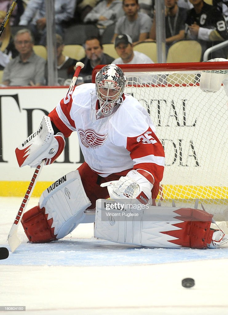<a gi-track='captionPersonalityLinkClicked' href=/galleries/search?phrase=Jimmy+Howard&family=editorial&specificpeople=2118637 ng-click='$event.stopPropagation()'>Jimmy Howard</a> # 35 of the Detroit Red Wings makes a save during the first period of a preseason game on September 16, 2013 at the CONSOL Energy Center in Pittsburgh, Pennsylvania.