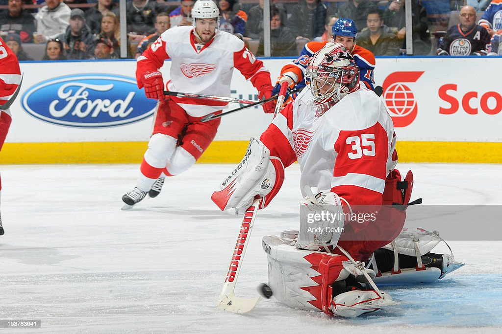 <a gi-track='captionPersonalityLinkClicked' href=/galleries/search?phrase=Jimmy+Howard&family=editorial&specificpeople=2118637 ng-click='$event.stopPropagation()'>Jimmy Howard</a> #35 of the Detroit Red Wings makes a save in a game against the Edmonton Oilers on March 15 2013 at Rexall Place in Edmonton, Alberta, Canada.