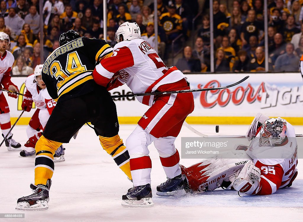 Jimmy Howard #35 of the Detroit Red Wings makes a save in front of Carl Soderberg #34 of the Boston Bruins in the third period in Game One of the First Round of the 2014 NHL Stanley Cup Playoffs at TD Garden on April 18, 2014 in Boston, Massachusetts.