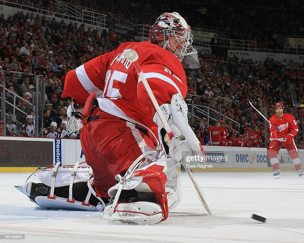 Jimmy Howard #35 of the Detroit Red Wings makes a save in the second period during a NHL game against the Colorado Avalanche at Joe Louis Arena on March 5, 2013 in Detroit, Michigan. The Wings won 2-1